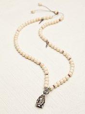 White Bead Buddha Necklace