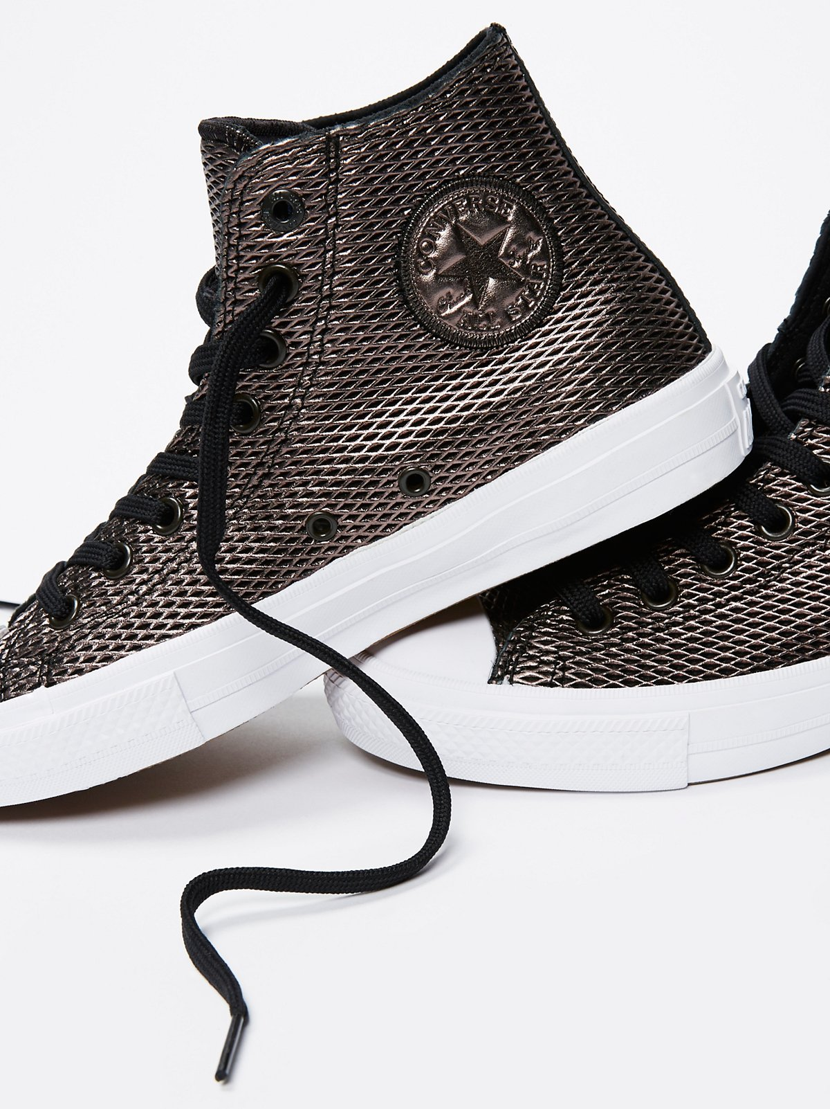 Perforated Metallic Leather Hi Top Chucks
